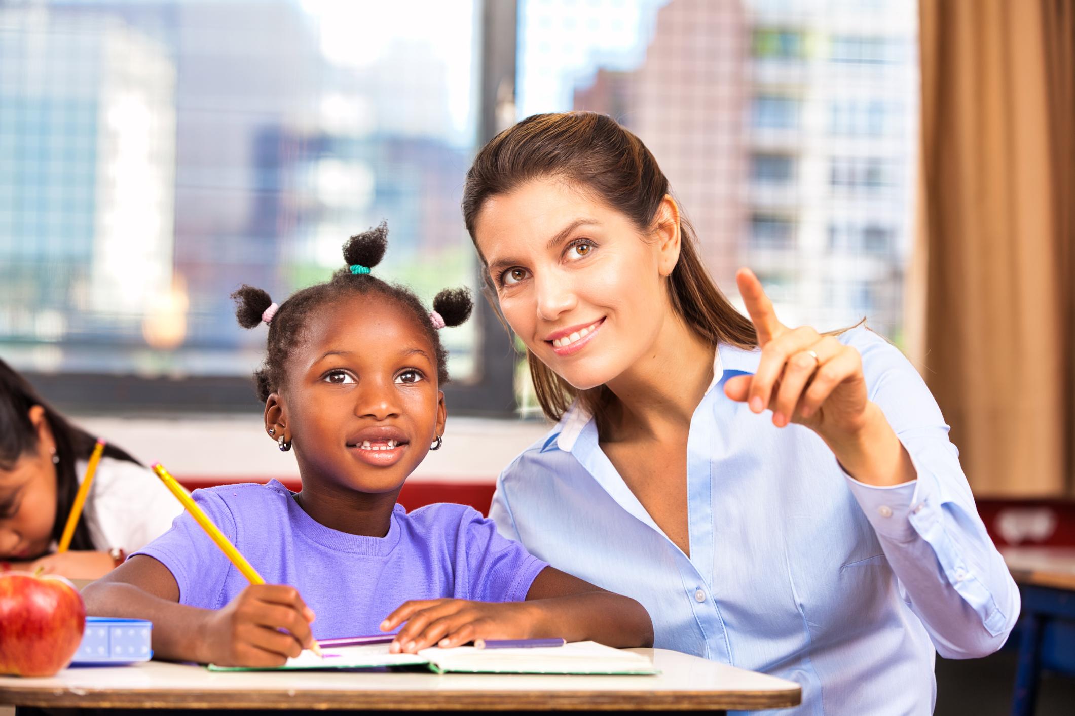 Teacher with student