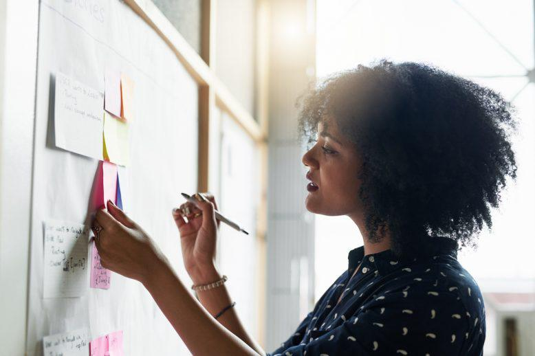 Woman drawing on sticky notes