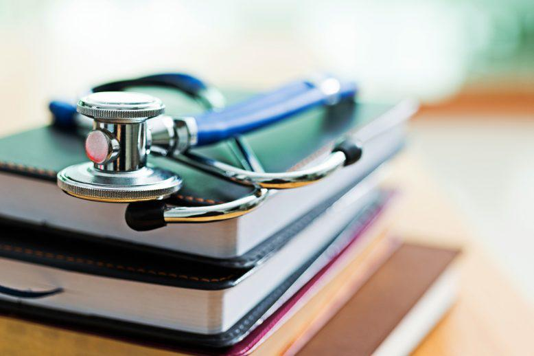 books with stethoscope on top