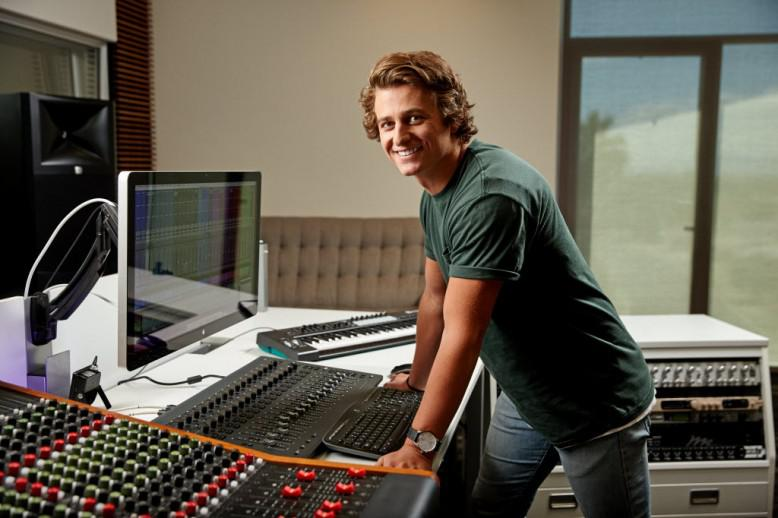 A student working at a soundboard