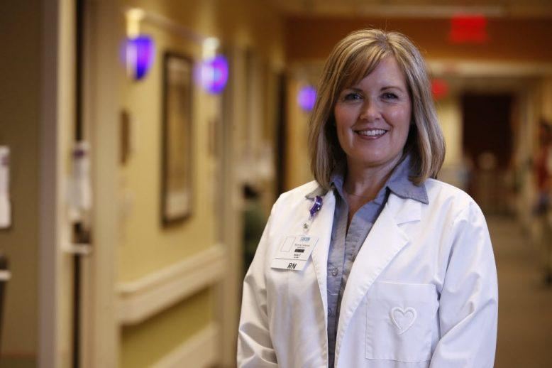 Woman in white doctor coat