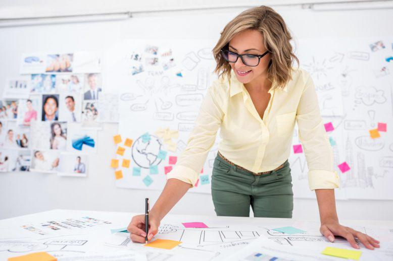 Woman works on marketing campaign storyboard
