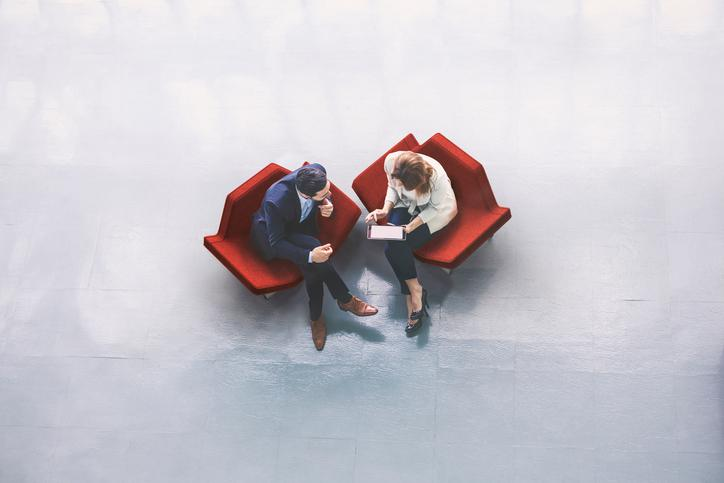 Two people consulting in chairs