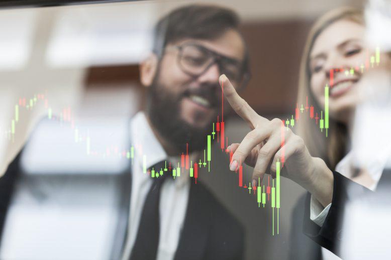 Man and woman view bar charts