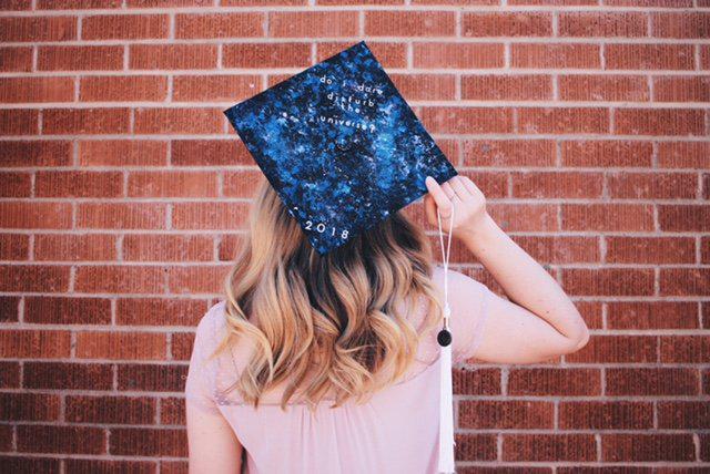 girl wearing graduation cap
