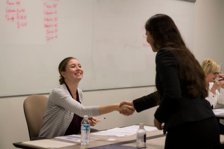 Honors student shaking teacher's hand