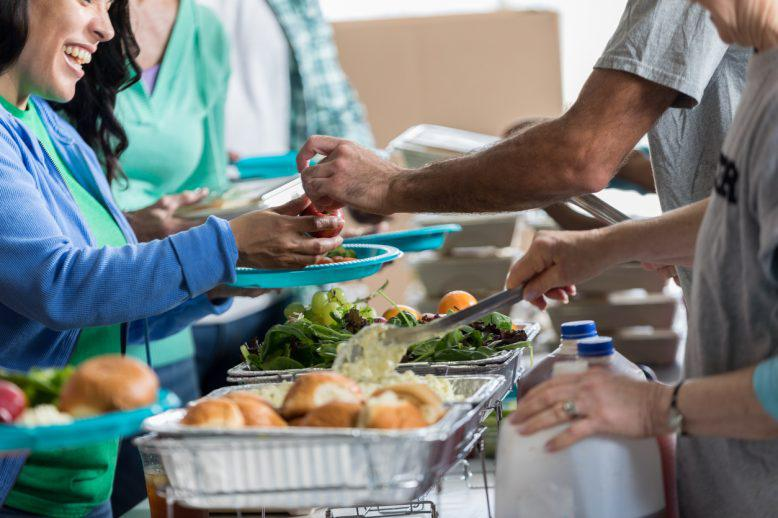 A soup kitchen serving people food