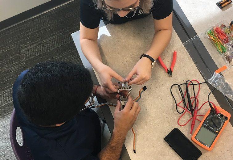 GCU students building a robotic hand