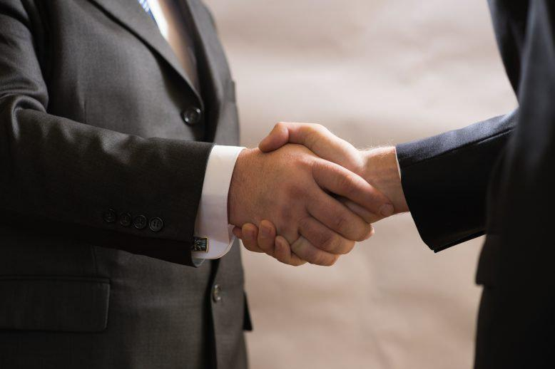 Two diplomats shaking hands
