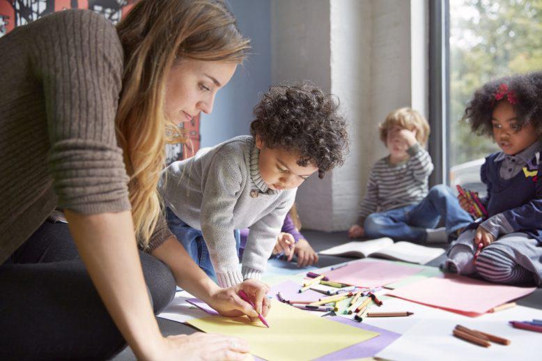 Female teacher working with kindergartners