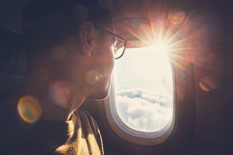 Man looking out of a plane window