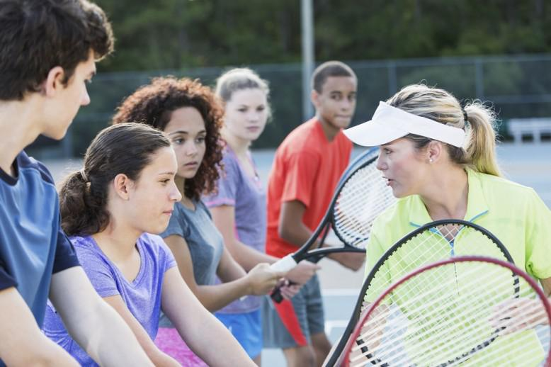 kids learning to play tennis