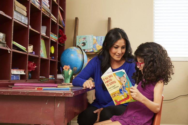 student reading with teacher