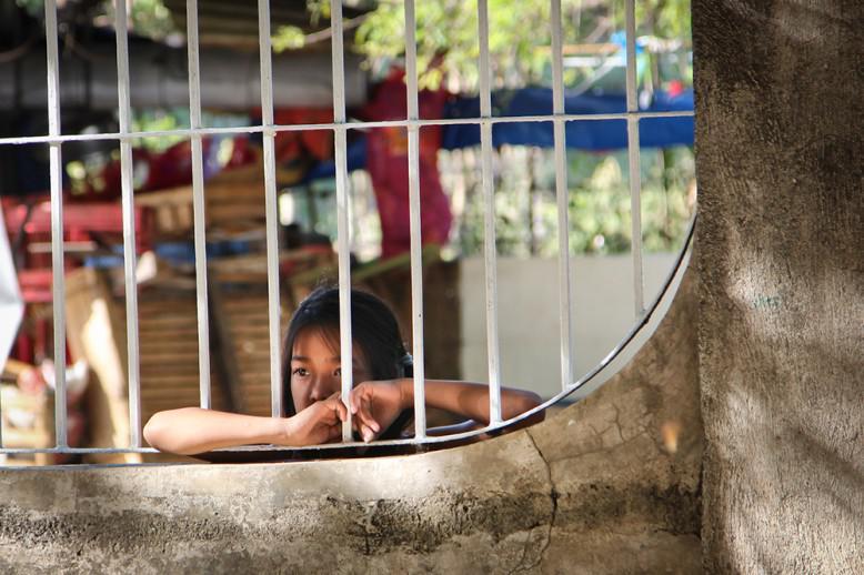 A girl looking through a window