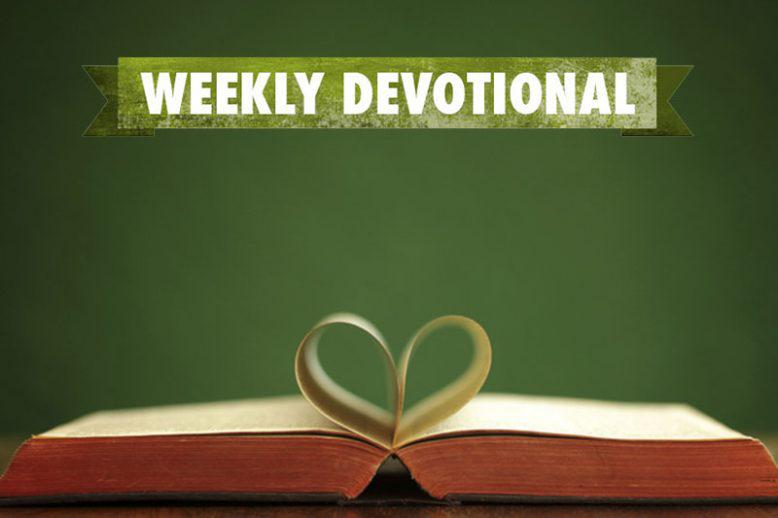 Weekly devotional text above open book with inner pages curled as a heart