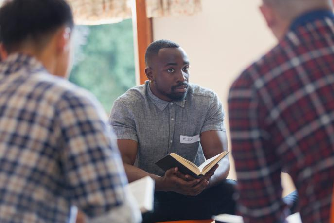 Alex listens during a men's Bible study