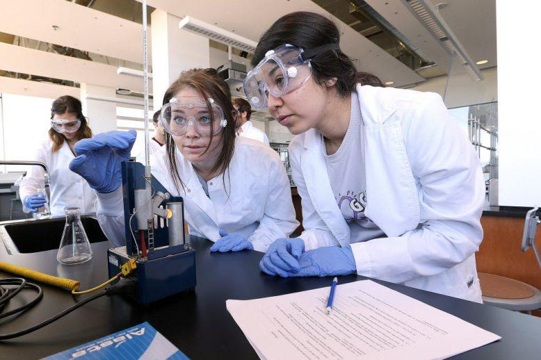 two chemistry students working on a lab