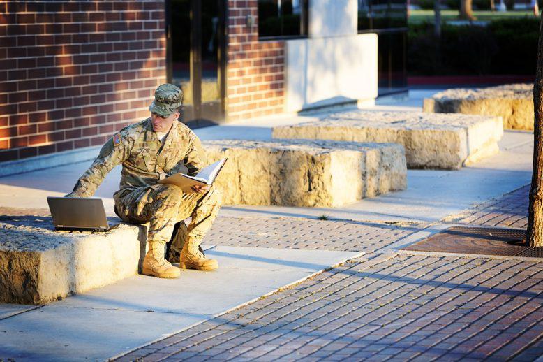 military student doing homework
