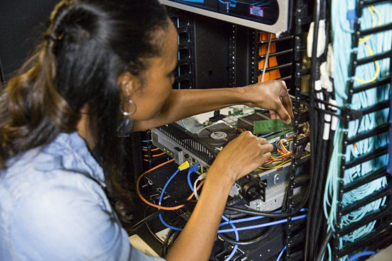 girl connecting wires together