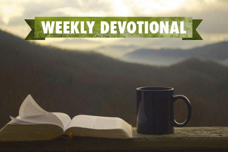 Mountain background with weekly devotional text over open book and coffee mug