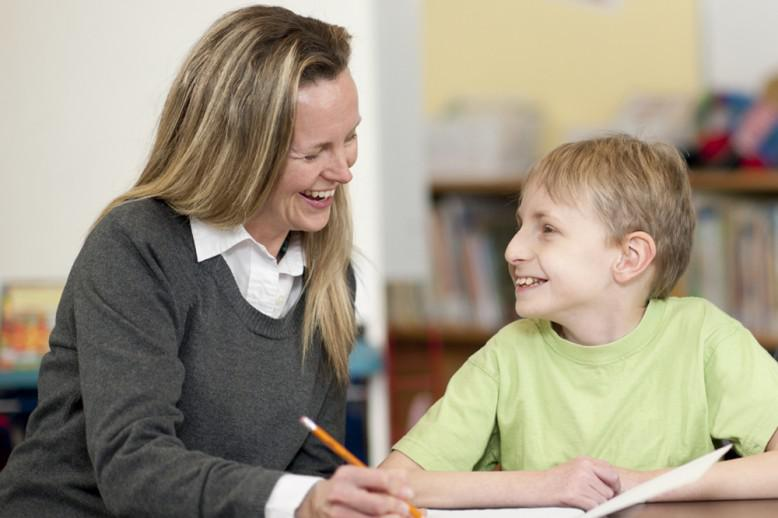 Woman teaching young student