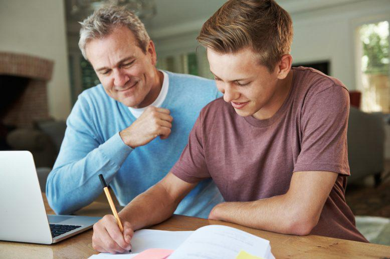 father homeschooling son