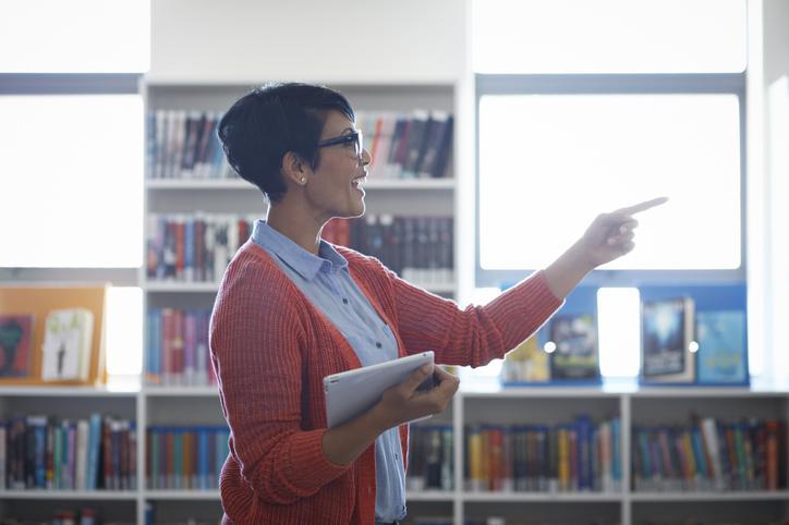 Teacher speaking in library