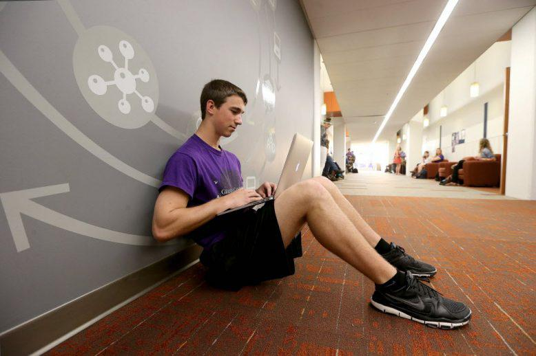 A GCU student working online