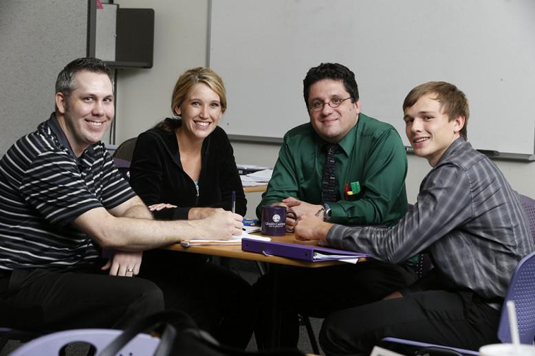Group of evening students meet together for discussion