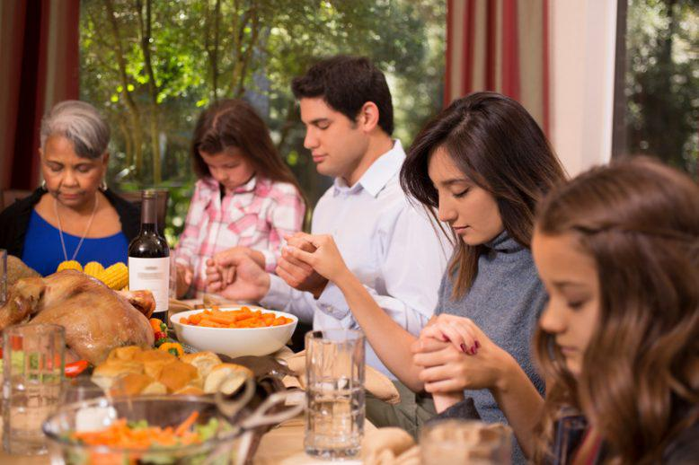 A family at the table on Thanksgiving