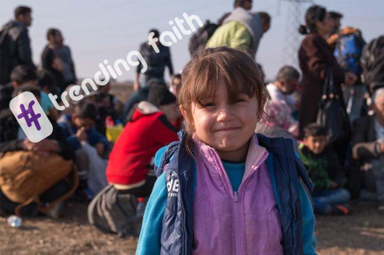 A group of refugees and a young girl with the trending faith logo