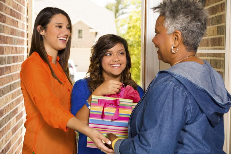 girl giving a gift to a woman