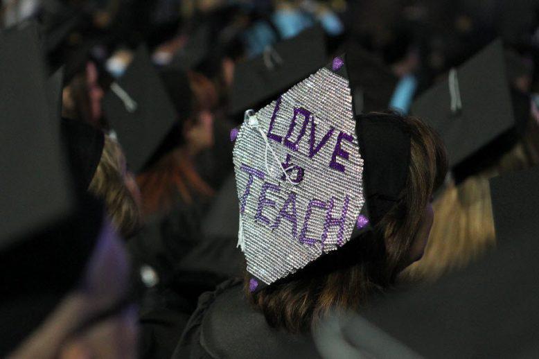 graduation cap that says love to teach