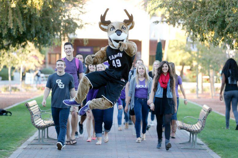Thunder walking with a group of GCU students on campus