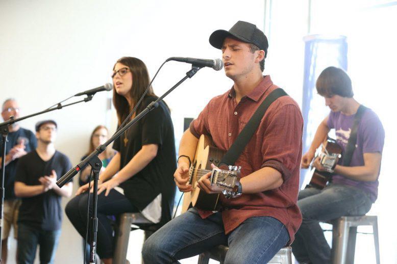 Three students playing music