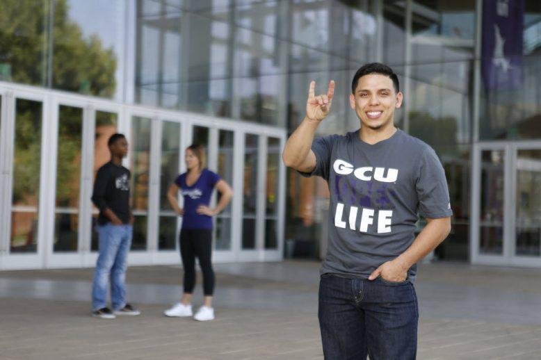 GCU student holding a lopes up