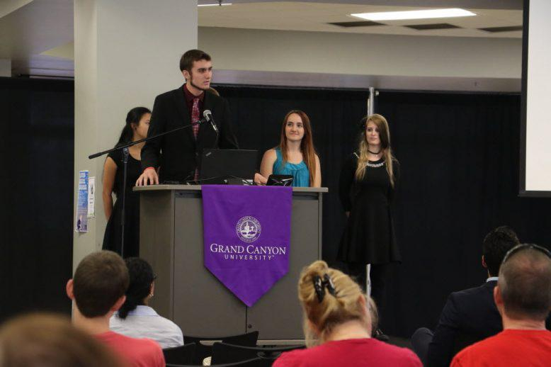 Honors students presenting at the symposium