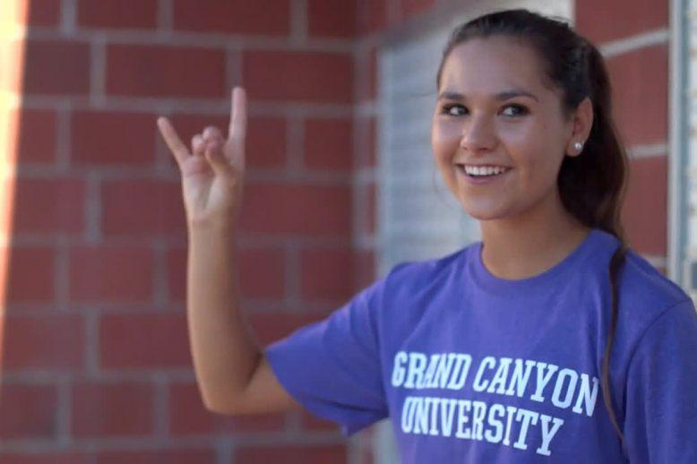 Tatum with a Lopes Up sign