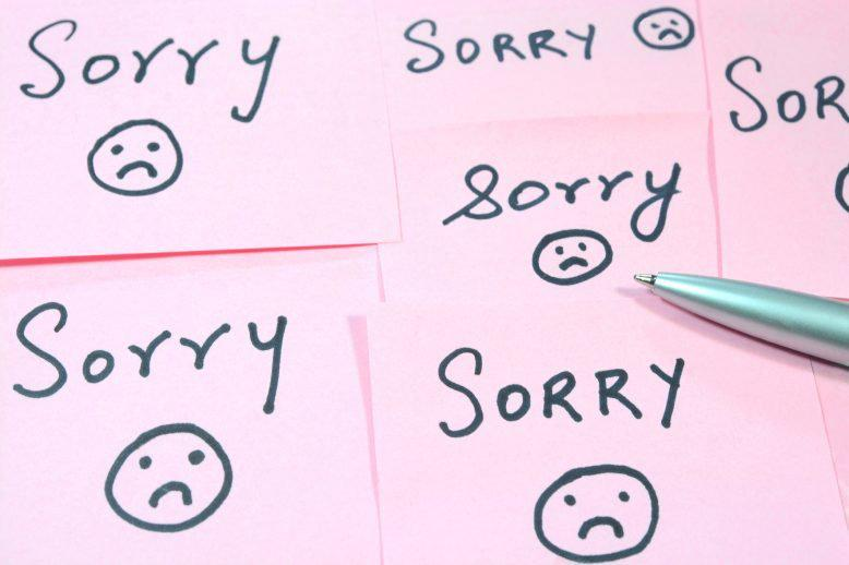 """Arranged sticky notes reading """"sorry"""""""