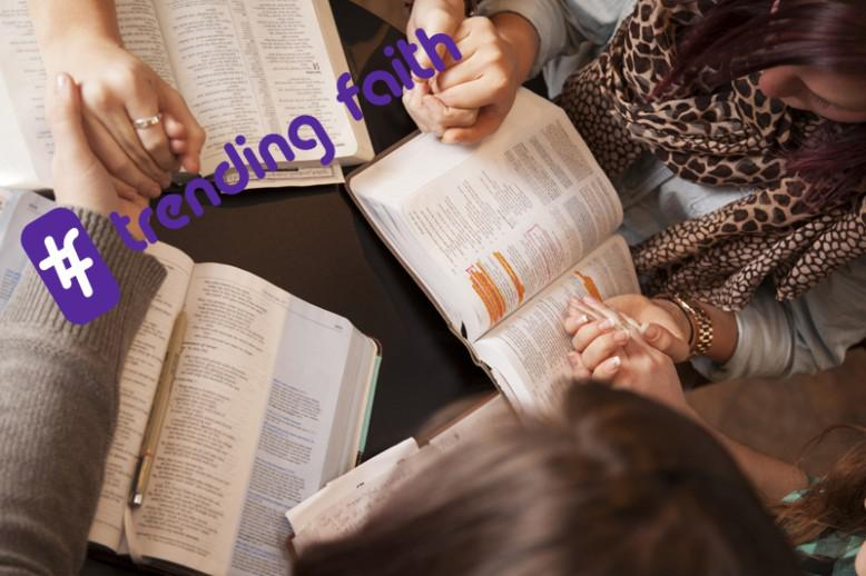 A group of people reading the Bible under the Trending Faith logo