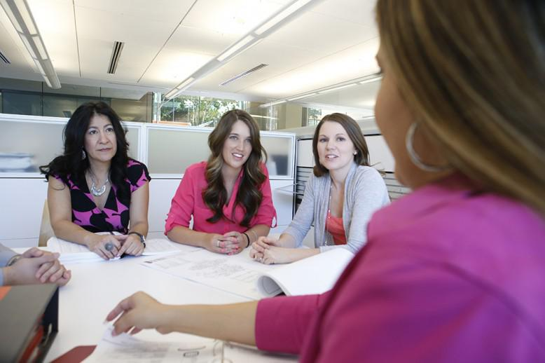 Group of female business leaders in a conference room