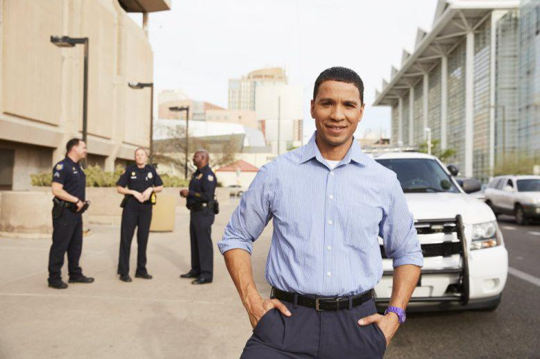 person in front of a cop car