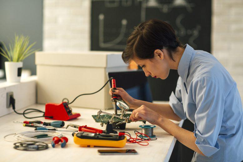 person working on electrical engineering