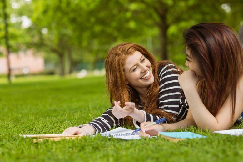 Students studying together outside