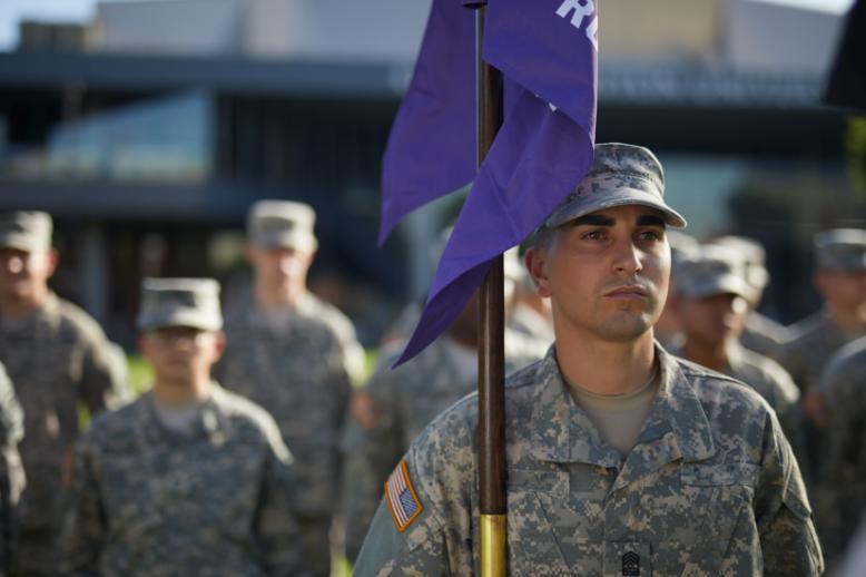 GCU veteran student holding a flag