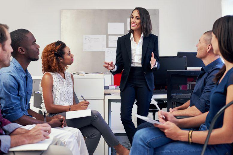 Female project manager talks to her team