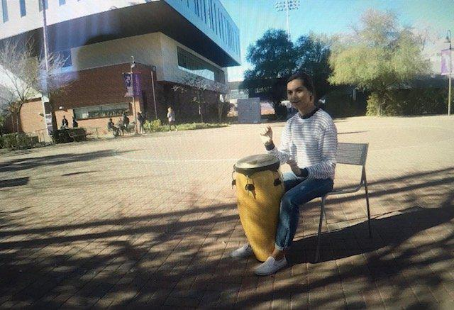 Tatum playing a drum at a campus club
