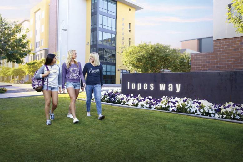 three GCU students walking on lopes way