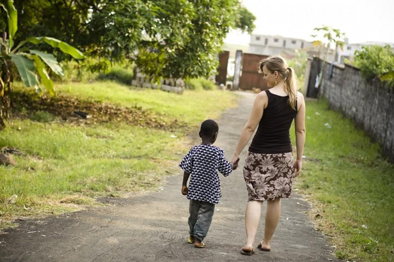 woman and child walking down a path