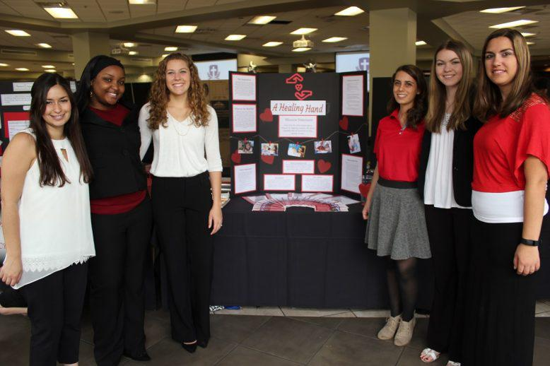 GCU Honors students in front of their symposium project